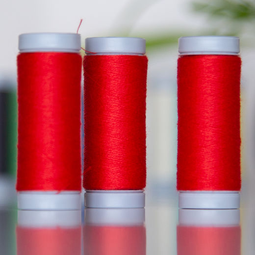 Bright red sewing thread