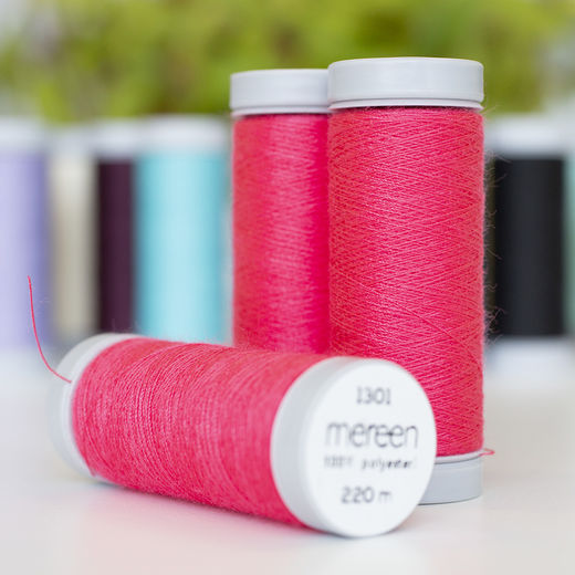 Bright coral sewing thread