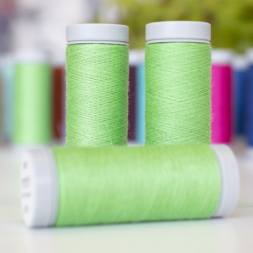 Bright green sewing thread