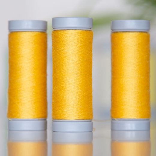Dark yellow sewing thread