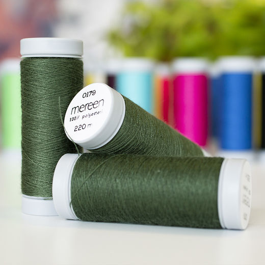 Dark green sewing thread